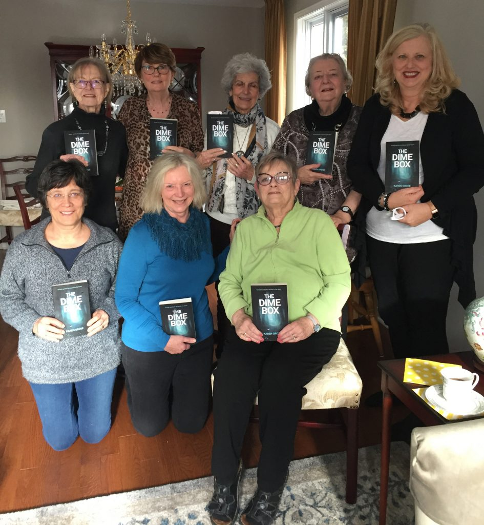 Book club members reading The Dime Box